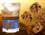 Blueberry granola bites bag with 4 bites and a mountain background