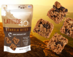 Latitude 40 Snacks Dark Chocolate granola bites bag with 4 bites and a mountain background