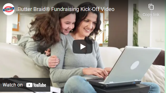Mom and daughter at laptop on the couch. Has the play video icon over the top.